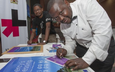 "Paul Mzungu  and Fatsani Menyani, journalist from Zodiac Broadcasting Corporation (ZBS) sign the HE FOR SHE campaign forms in support of gender equality at the premiere of the movie, ""Mercy's Blessing""."